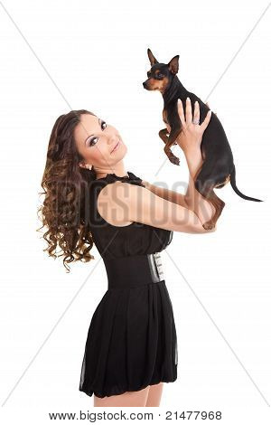 Young Woman And Sweet Puppy Playing