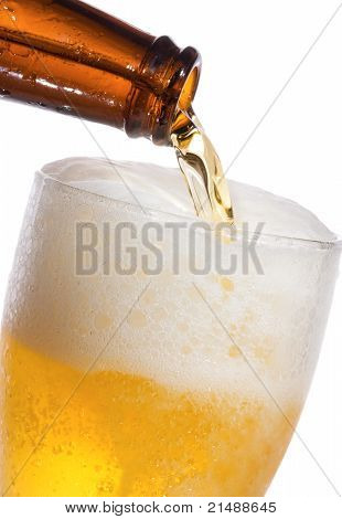 Beer Is Pouring Into Glass