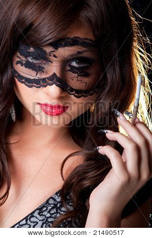 Attractive brunette with lacy mask on eyes