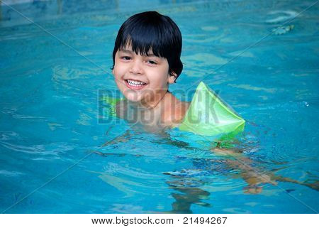 A Hispanic boy at the pool