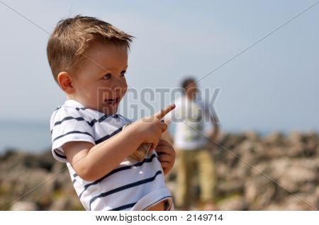 Small Cute Boy Playing Outdoors