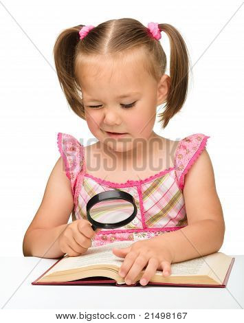 Little Girl Play With Book And Magnifier