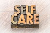 self-care word abstract in vintage letterpress wood type poster