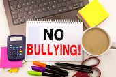 No Bullying Text In The Office With Surroundings Such As Laptop, Marker, Pen, Stationery, Coffee. Bu poster