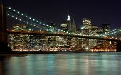 pic of brooklyn bridge  - New York City Skyline with Brooklyn Bridge as seen from Brooklyn nice city lights and flowing East River in foreground - JPG