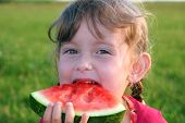 stock photo of summer fun  - A child savors her favorite flavor of summer - JPG