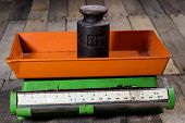 Old Weight And Weights On A Wooden Table. Old Used Kitchen Scale With Old Scale And Kilogram Weight poster