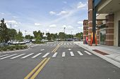 stock photo of parking lot  - Parking lot outside of mall and kayaks - JPG