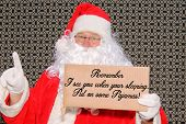 Santa Claus with a funny Cardboard Sign Santa Sign reads REMEMBER I SEE YOU WHEN YOUR SLEEPING, PUT  poster