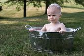 stock photo of hot-tub  - Image of a cute toddler sitting in a galvanized tub in the grass - JPG