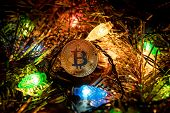 Gold Bitcoin Decoration On Christmas Tree poster