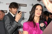 LOS ANGELES - APR 7: Demi Moore, Ashton Kutcher at the premiere of 'The Joneses' at the ArcLight The