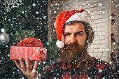 Santa Claus Man With Present Box At Christmas Tree poster