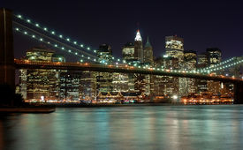 stock photo of brooklyn bridge  - New York City Skyline with Brooklyn Bridge as seen from Brooklyn nice city lights and flowing East River in foreground - JPG