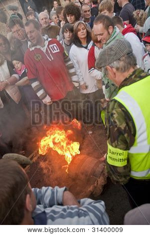 A Carnival Committee Member Lights The Tar Barrel At The Start Of The 2011 Tar Barrels Of Ottery Car