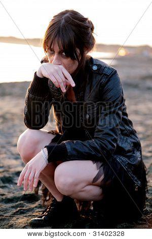 Sad Woman On The Beach And Sunset