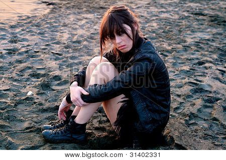 Sad Woman On The Beach After Violence