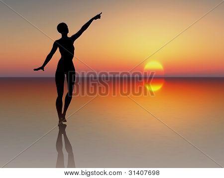 Woman reaching for the rising sun