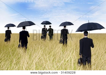 Businessmen With Umbrella Outdoor