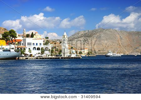 Greece. Dodecanesse. Island Symi (Simi). Colorful houses on rocks.