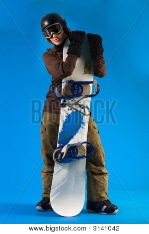 Woman With Long Curly Hair Presenting Her Snowboard
