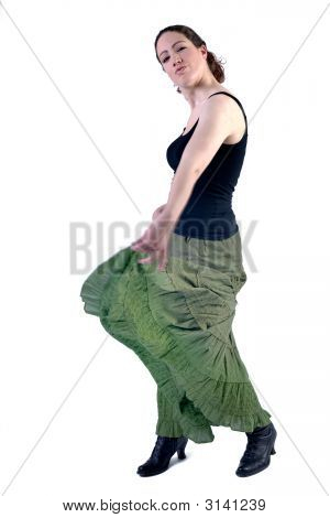 Woman With Long Curly Hair In A Dress Dancing