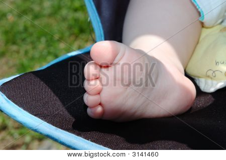 Baby's Foot In Carriage.