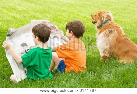 Boys Reading The Newspaper