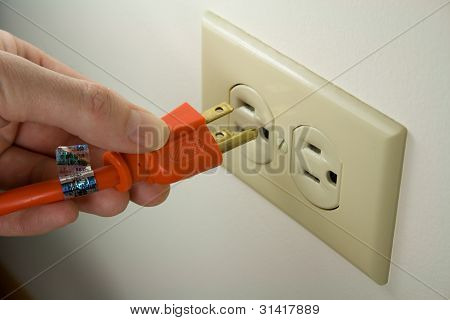 Plugging Power Cord into Wall Outlet