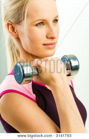 Girl Holds Barbell