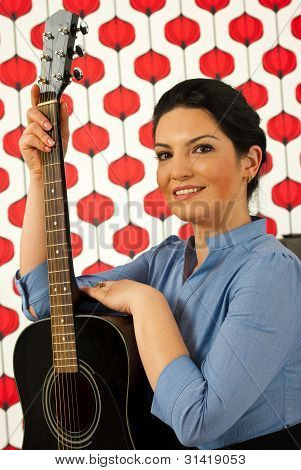 Happy Musician Woman With Guitar