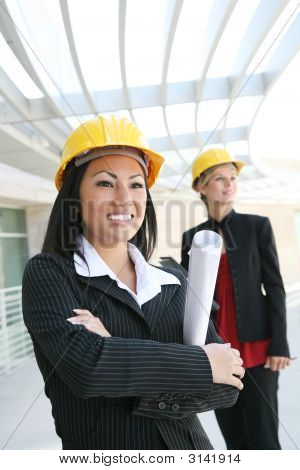 Pretty Women Architects On Construction Site
