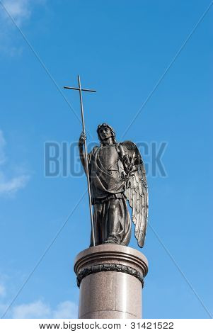 Statue Of An Angel With A Cross.
