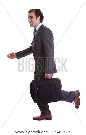 businessman walking with laptop