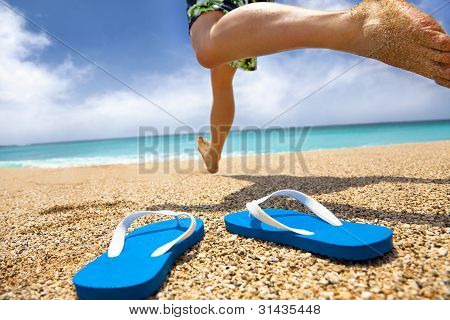man running on the beach and slipper
