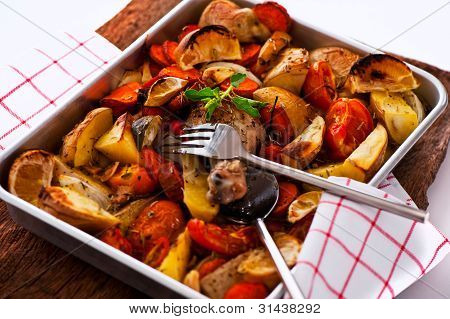 Chicken With Vegetables On A Baking Tray As A Studio Shot
