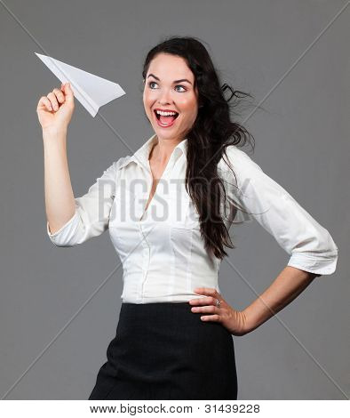 Beautiful Smiling Woman Holding A Paper Airplane