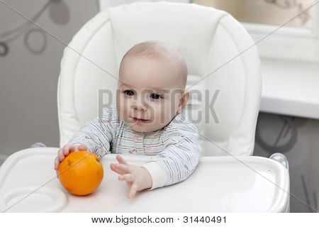 Baby Taking Orange