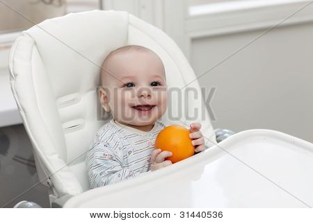 Laughing Baby With Orange
