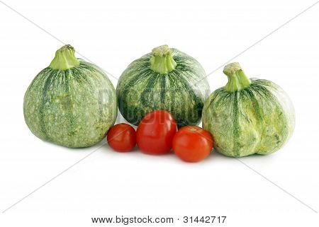 zucchinies and red tomatoes