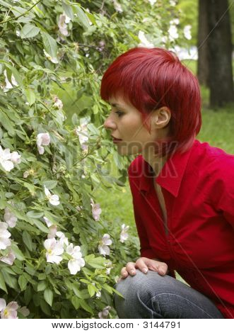 Girl Smells A Rose