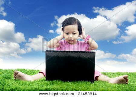 Asian Girl Worries Looking At Her Laptop