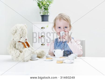Child Drink Tea With Bagels.