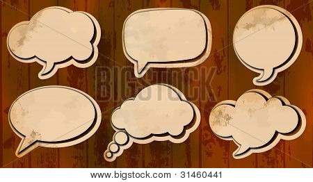 Aged cut out speech bubbles
