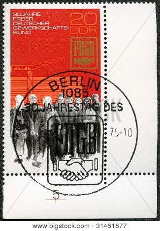 Germany - Circa 1975: Shows Construction Workers, Union Emblem And Dedicated Free German Association