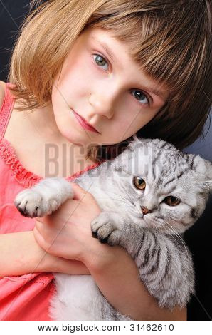 Child With Her Pet Cat