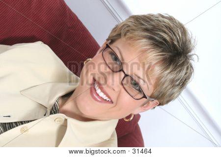 Business Woman In Beige Wearing Glasses