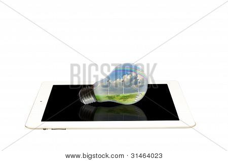 Light Bulb With Turbine Power Generator On White Tablet Pc