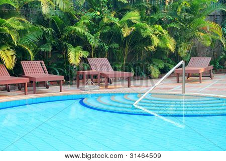 Wooden Pool Trestle Beds By The Poolside