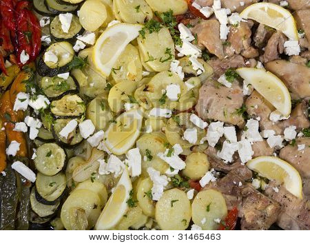 Baked chicken legs  with young potatoes, feta cheese and organic vegetables